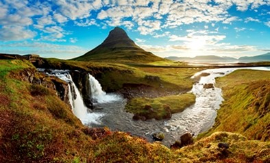 Rural summer scene of mountain and stream in Iceland