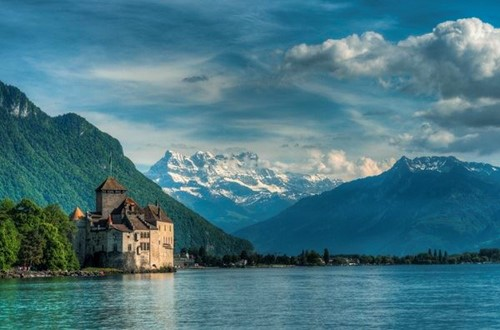 Chillon Castle with snow-capped mountains in the background